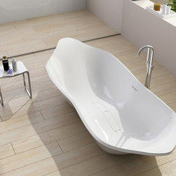 Aqua Brezza Bathtub - The Brezza Bathtub has the appearance of natural stone, but it's considerably lighter so it can be safely installed in the average home. The composite stone material is hard-wearing, stain resistant and easy to keep clean, which is why our bathtubs can be found installed in 5-star luxury hotels. This luxury tub is comfortable, soft to the touch and non-slip – they offer a sensual bathing experience. This unique minimalist designs make this bathtub the ideal center piece for any bathroom. It is fire retardant and resistant to mold, mildew and bacteria. Eco-friendly insulation properties help maintain the temperature of the water in our bathtubs for a longer, more relaxing bathing experience.