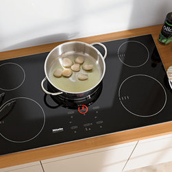 Miele KM5773 - Miele's induction cooktops offer a distinctive, non-contact method of heating using magnetic fields to transfer energy directly to cookware.