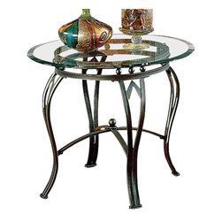 Steve Silver - Madrid End Table - Glass Top - Sturdy construction and design details make this end table a must have. The Madrid end table is made of metal with a glass top. Wrapped in a powder paint finish, the table appears as a weathered pewter with a hint of green patina. Legs are in a curved with an X brace support.