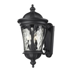 Five Light Black Water Glass Wall Lantern - Traditional and timeless, this large outdoor wall mount combines black cast aluminum hardware with clear water glass for a classic look.