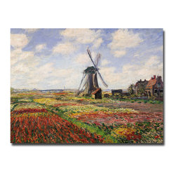 Trademark Fine Art - Claude Monet 'Tulip Fields with Rijnsburg Windmill, 1886' Canvas Wall Art - Dress up your walls with the work of a master artist with this gallery-wrapped Claude Monet art reproduction. This giclee print on canvas wall art is a landscape composition that will add valuable color and style to any room in the home or office.