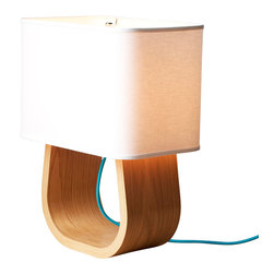 Ciseal - Michigan Left Table Lamp, Oak/Blue - Named The Michigan Left after our great state's unique intersections which replace normal left turns with a U-Turn followed by a right turn.  The clean, modern U-shaped base of this table lamp simply yet beautifully highlights the gorgeous layers of plywood and grain of the wood.  It's the perfect addition next to your couch, beside your bed, on your desk, or just about anywhere you need some light.