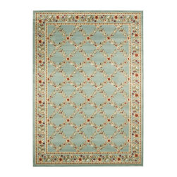 Safavieh - Lyndhurst Trellis Gardens Blue Rug (6'7 x 9'6) - This intricate blue rug features a beautiful Oriental floral pattern. This rug has a thick,plush pile,but the power-loomed polypropylene construction ensures that it is both low-shedding and able to withstand even heavy foot traffic.
