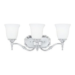 Quoizel Tritan TT8603C Bath Fixture - 22W in. - Polished Chrome - Classic design can take many shapes and forms, but one of the best is the Quoizel Tritan TT8603C Bath Fixture - 22W in. - Polished Chrome. With a tastefully traditional aesthetic, this bath fixture has a steel frame that's finished in a shiny polished chrome. The three glass shades have a bell-shaped silhouette that wonderfully complements the metal accents and curved arms. The fixture requires three 100-watt medium base bulbs, not included.About Quoizel LightingLocated in Charleston, South Carolina, Quoizel Lighting has been designing timeless lighting fixtures and home accessories since 1930. They offer a distinctive line of over 1,000 styles, including chandeliers, lamps, and hanging pendants. Quoizel Lighting is the perfect way to add an inviting atmosphere to any area in your home, both indoors and out.