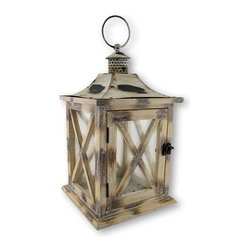 Zeckos - Wood and Glass Craftsman Style Candle Lantern Distressed Finish - It's all about the lighting It sets the mood in any room or social setting. This distinctive craftsman style candle lantern will put you and your guests at ease with the soft illumination of a glowing candle. This rustic finish wood and glass candle lantern has a metal insert in the bottom, and a metal top for safety. It is hand-crafted and hand-painted in an antique white finish. It measures 12 inches high, 7 inches wide and 7 inches long. The interior will accommodate pillar style candles up to 4 3/4 inches in diameter. Perfect to light-up the patio at your next gathering, or hang it on the front porch with the hanging ring as you swing the night away It's also a wonderful way to showcase your table using it as the centerpiece. It makes a wonderful housewarming gift as well