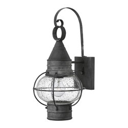 "Hinkley - Hinkley Cape Cod 18"" High Aged Zinc Outdoor Wall Light - An attractive accent for your outdoor space, caged clear seedy glass and an aged zinc finish lend classic sophistication to this outdoor wall light. Featuring a solid aluminum construction for durability that will stand up to the elements, this outdoor wall light is a striking traditional accent full of charm and old world appeal. Thin metal caging encloses the clear seedy glass globe and is capped at the top and bottom with metal accenting, all finished in rustic aged zinc. The light fixture is securely mounted to the flush mount base plate, but also features a curved metal hanger that lends classic charisma to this fixture from the Cape Cod Collection by Hinkley Lighting."