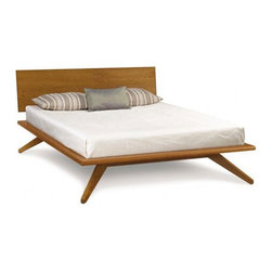 Magnolia Platform Bed - Perfectly mid-century, the Magnolia Platform Bed stands out from the crowd with its impressively minimal aesthetic and angled legs. This beauty is made from solid wood, all of which is certified environmentally sustainable. If you're looking for a sturdy, American-made bed, call off the search and take a nap right here.