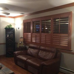 LI's Shutter Specialists to the Rescue! - The look of real wood always has a very warm and inviting atmosphere.  These Hunter Douglas Heritance Hardwood shutters look great with the matching wood molding going around the room.  Hardwood shutters are a very classy and expensive looking treatment.