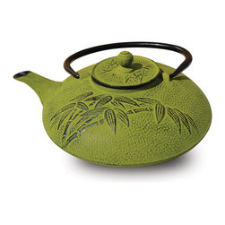 """Moss Green Cast Iron """"Positivity"""" Teapot, 26 Oz. - Unity Cast Iron """"Positivity"""" Teapot – Moss Green Finish. Graceful, elegant cast iron Tetsubin teapot crafted in the Japanese style Inspired by highly prized antique Japanese cast iron teapots still in use today. Features a black enamel interior Coated that helps prevent rust Includes a stainless steel tea brewing basket for ease of preparation For brewing and serving tea. Not intended for stovetop use. 26 Oz.. capacity Hand Wash"""