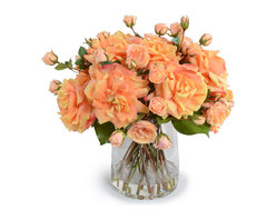 New Growth Designs - Salmon Roses Arrangement - Sweet peachy roses from bud to full bloom add a magical touch to your favorite setting. Equally magical? This beautiful bouquet will last till happily ever after! Silken stunners so lifelike, everyone will think you cut them from your garden this morning.