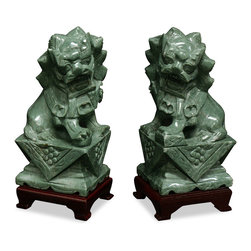 "China Furniture and Arts - Hand Carved Jade Foo Dogs - Always standing in pairs, Foo Dogs are fantasy lions in Chinese mythology that serve as guardians to prevent harmful things from happening to the family. The male, with a paw on a symbolic ball, protects the world, while the female, with a paw on a cub, protects the dwelling. Hand carved of precious jade stone, they can be seen stylized in many different fashions. Color and sizes may vary slightly for each pair due to the handcrafted nature of each piece. Please allow us to select for you. Matching wooden stands included and measures 4""W x 3.25""D x 1.25""H. Sold as a pair."