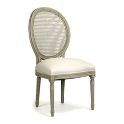 Kathy Kuo Home - Pair Madeleine French Country Oval Caned Olive Dining Chair - Open up your dining room with these cane-backed dining chairs. Their muted olive-rubbed finish and natural linen fabric brings light and life to your French country décor or contemporary dining room. These chairs will be equally appropriate paired with a reclaimed vintage wooden table or a lacquered modern buffet.