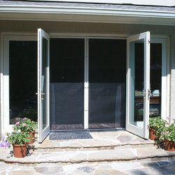 Retractable screens for doors - Inswing, outswing and sliding glass doors, these Phantom retractable screens allow you to open your doors and allow the outside in without the bugs.