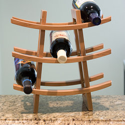 Lipper International - Nine-Bottle Wine Rack - Featuring durable and sustainable bamboo construction, this unique wine rack looks as fabulous as it is functional.   13.13'' W x 12.63'' H x 7'' D Holds nine bottles Bamboo Hand wash Imported