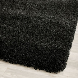 Safavieh - Safavieh Cozy Solid Black Shag Rug (3' x 5') - Add warmth and style to any room with this elegant black shag rug. Made of 100 percent polypropylene,this casual-style rug features a thick,plush pile for softness and comfort,and comes in a classy black color for a whimsical appeal.