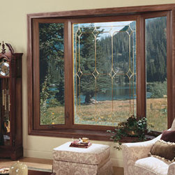 Bay and Bow Windows: Custom-Made, Energy-Efficient  Windows - This Bay Window features a dark oak woodgrain and beveled-leaded glass - options that add special elegance to any room. Photo by Alside