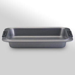 Anolon - Anolon Advanced Bakeware 9 x 13 in. Rectangular Cake Pan - 54706 - Shop for Cake Pans from Hayneedle.com! Upgrade that tired old cake pan to something that is made for hard-working kitchens with the Anolon Advanced Bakeware 9 x 13 in. Rectangular Cake Pan. Made with carbon steel and has a nonstick surface this pan is built to deliver the goods - all in one piece. It features silicone-grip handles for added comfort and is dishwasher-safe.About Anolon CookwareFor those who think recipes are more like suggestions meet Anolon - a leading brand of gourmet cookware designed to empower food enthusiasts to creatively express themselves in the kitchen. Anolon gives home cooks the ability to cook outside the recipe by offering a wide selection of high-performance exceptionally crafted cookware bakeware cutlery tools and gadgets that satisfy the needs of each home chef's unique cooking style. Celebrate creativity in the kitchen with Anolon.