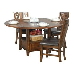 Winners Only - Zahara Dining Table w Drop Leaf - Chairs not included. Granite lazy Susan top. One drawer and storage shelf. Medium oak finish. No assembly required. Minimum: 42 in. L x 42 in. W x 30 in. H. Maximum: 60 in. Dia. x 30 in. H