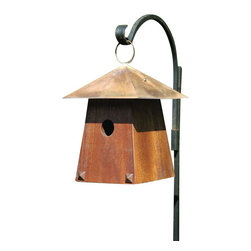 Heartwood - Avian Bungalow Bird House -Mahogany - This  beautiful  birdhouse  is  the  perfect  addition  to  any  home  or  garden  of  your  choice.  The  graceful  lines  and  angles  of  a  migrating  flock  inspired  this  Craftsman  style  bungalow.  The  gently  sloping  body  topped  with  a  hand-burnished  copper  roof  and  large  hanging  loop  are  the  perfect  accents  and  pieces  for  this  home.  This  bird  house  is  one  you  are  sure  to  enjoy  in  the  years  to  come.                  8x8x12              1-3/8  hole              Handcrafted  in  USA  from  renewable,  FSC  certified  wood
