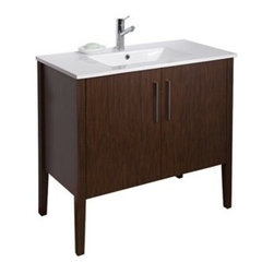 "Vigo Industries - VIGO 36"" Maxine Single Bathroom Vanity - Wenge - Elegance is at your fingertips with this beautiful VIGO bathroom vanity. No other brand can match VIGO's style, quality and design. This 36-inch freestanding vanity features double, soft closing doors with two sleek vertical chrome finished handles, while the interior features a pull out drawer plus storage shelf. The VIGO Maxine collection is a modern and assertive addition to any bathroom. Features Cabinet is constructed of engineered wood with wood veneers, in a Wenge finish, consisting of an anti-scratch surface for enhanced durability. Interior features a pull out drawer plus storage shelf Contains one white porcelain countertop featuring a fully integrated sink with a single hole for easy faucet installation Includes solid brass, chrome-plated drain assembly All mounting hardware included Vanity is fabricated for freestanding installation This cabinet is shipped assembled 5 Year Limited Warranty Faucet NOT included How to handle your counterView Spec Sheet"