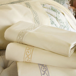 Jardin Sheet Set - A subtle yet sophisticated way to dress the bed, our inviting ivory sheets are embellished with densely embroidered scrolls. This lovely treatment trims the edges of our flat sheets and both sides of our pillowcases.