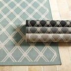 Ballard Designs - Tricia Trellis Indoor/Outdoor Rug - The trellis-patterned blue and white rug could set the tone for a whole room. Blue is a such a serene color for a relaxing space.