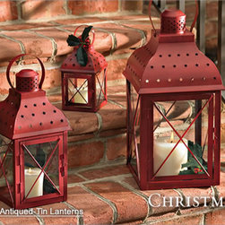 Red Antiqued-Tin Lanterns - These weathered lamps are perfect to bring the burgundy trend to your outdoor patio. In the summer, use with citronella candles to ward away mosquitoes.