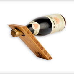 Accessories - This unique balancing bamboo wine bottle holder is made by hand, and sealed with a rubbed-in oil finish. The 3-ply construction of the bamboo reveals a beautiful cross-section through the material, creating a one-of-a-kind effect. This holder makes a great conversation piece and offers a beautiful way to display a bottle of wine. These sculptural holders make great gifts for people who love wine.