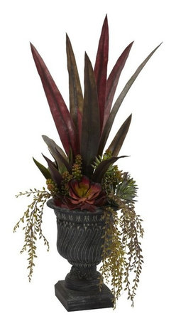 """27"""" Mixed Succulent with Urn - Here's a mix of plants and succulents that are exciting enough individually, but when combined, easily exceed the sum of their parts. if a picture is worth a thousand words, just take a look at this 27"""" beauty - see the different textures, the angles, the deep colors. . this arrangement """"speaks"""" to certain people. And if you're one of them, it's a must-have. Comes complete with a decorative pot. Height= 27 In. x Width= 19 In. x Depth= 11 In."""