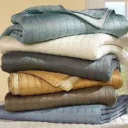 Channel Silk Quilt, King/California, Lagoon - Woven from a blend of silk and cotton, our Silk Channel bedding is breathable and smooth. Rows of channel stitching on both sides make it completely reversible. Satin woven from a silk/cotton blend. Pure cotton batting. Quilt and sham reverse to self. Sham has a button closure. Quilt, sham and insert sold separately. Dry-clean Only. Imported.