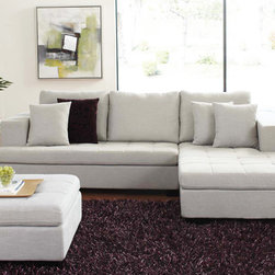 Mirak Sectional with Ottoman - You'll love the comfort and design of our new Mirak sectional. It comes with an ottoman which can be moved around to create a unique lounging space. Stocked in a light gray fabric with tufted seating and venge block legs. You can also custom order from a variety of fabrics at one low price. (The Mirak shown here in a black fabric is a custom order fabric, not stocked.) Please allow 12 weeks for special orders. The Mirak sectional and ottoman can also be purchased separately, Sectional, $1095. Ottoman, $300. Storage ottoman also available by special order, $499.