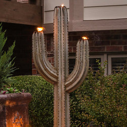Frontgate - Cereus Outdoor Torch - 5'H - Constructed of durable galvanized steel. Rust-resistant and guaranteed not to corrode. Withstands winds of up to 90 miles per hour. Develops a slight patina over time to give it even greater depth. Hollow and perforated throughout with a hole in the base, which allows for landscape lighting to be added for a special evening glow. Carefully crafted to realistically represent the beloved Saguaro Cactus, our Cereus Torch easily lets you illuminate your landscape with the beauty of the badlands. This work of art expertly combines a landscape sculpture with unparalleled creative detail and three tiki torches for an outdoor accent that's unique, functional and durable.  .  .  .  .  . Includes three refillable torch canisters . Made in the USA.