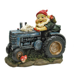 EttansPalace - Garden on Tractor Gnome Statue - When you could use a little gnome magic in a garden flowerbed or vegetable plot, our garden gnome statue is at the ready! Sporting a pointy red elf hat and full gnome beard, this exclusive garden gnome figurine plows his fields with his trusty farm tractor and bunny friend. Imaginatively sculpted, our garden gnome sculpture is lovingly made of quality designer resin and then hand-painted one piece at a time exclusively by Toscano skilled artisans. Extend a warm welcome to all visitors to your home or garden. Another quality garden gnome sculpture from Toscano!