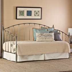 Hillsdale Furniture - Hillsdale Ivy Metal Daybed - 1218DBLH - Shop for Daybeds from Hayneedle.com! Elevate your multi-use room with the graceful Hillsdale Ivy Metal Daybed. This daybed features a durable metal frame in an aged pewter finish that makes it an easy fit in any design aesthetic. Traditional vertical bars and vine-inspired scrolls plus arches and decorative finials add classical grace. This timeless bed looks sumptuous when piled with luxurious bed linens pretty when layered with pastel colors and casual with rustic textural blends. Some assembly required. Add on a suspension deck (included on all configurations) or the optional roll-out trundle for even more functionality. About Hillsdale FurnitureLocated in Louisville Ky. Hillsdale Furniture is a leader in top-quality affordable bedroom furniture. Since 1994 Hillsdale has combined the talents of nationally recognized designers and globally accredited factories to bring you furniture styling and design from around the globe. Hillsdale combines the best in finishes materials and designs to bring both beauty and value with every piece. The combination of top-quality metal wood stone and leather has given Hillsdale the reputation for leading-edge styling and concepts.