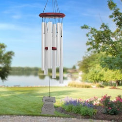 Chimes of Your Life Personalized Dog Wind Chime - Hand-tuned to ancient pentatonic notes the Chimes of Your Life Personalized Dog Wind Chimes produce a calm soothing sound that relaxes your body and mind and brings a sense of tranquility to your surroundings. But what sets these personalized wind chimes apart from the rest is that each dog wind chime is engraved with your own thoughts and feelings and custom made just for you! Each side of the chime's wind sail can be inscribed with up to 300 characters (per side) of text. Your personal message is expertly engraved on both sides of the silver or bronze wind sail in black creating a high-contrast easy-to-read inscription. A professional graphic artist chooses the formatting spacing between paragraphs centering and font size based on the wind sail design and content of your inscription creating the perfect wind chime for you. The top pieces and strikers of these chimes are made of Ash hardwood stained in beautiful warm red and finished with clear semi-gloss polyurethane to protect the wood for years to come. The pentatonic-tuned tubes are made of non-rusting anodized aluminum and coated with a lasting weather-resistant bronze or silver finish. The acrylic dog-shaped wind sail comes in matching silver or bronze. Available in 19-inch 29-inch or 39-inch overall lengths. An excellent way to celebrate your love for your special pet the Chimes of Your Life Personalized Dog Wind Chimes make thoughtful gifts that are sure to be cherished for years to come. Personalization: A professional graphic designer will format your message to fit the wind sail perfectly based on all elements - sail shape and the content of your inscription. Inscription is limited to a maximum of 300 characters (each side). Wind sail area provides enough space for a small poem. Message will be engraved on both sides. Personalized wind chimes make appropriate gifts for weddings anniversaries retirement and memorials for people or pets. Wind Chime Length: 