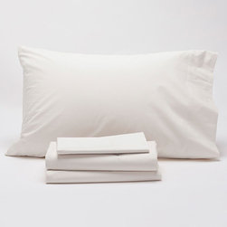 """Coyuchi - Coyuchi 220 Percale Sheet Set - This contemporary Coyuchi sheet set offers versatile style to a modern bedroom. Softer with each wash, this woven bedding set's plush texture exudes indulgent sophistication. Includes one fitted sheet, one flat sheet and two pillowcases; Available in full, queen and king sizes; Available in natural or white; 220-thread count; Machine washable; Full: Fitted sheet: 54""""W x 75""""H, flat sheet: 90""""W x 106""""H, pillowcase: 32""""W x 20""""H; Queen: Fitted sheet: 60""""W x 80""""H, flat sheet: 90""""W x 106""""H, pillowcase: 32""""W x 20""""H; King: Fitted sheet: 78""""W x 80""""H, flat sheet: 98""""W x 106""""H, pillowcase: 40""""W x 20""""H"""