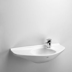 """Toto - Toto LT650G#01 Cotton  29-1/2"""" Wall Mounted Bathroom Sink with Single - Product Features:Round basin gives a simplistic yet elegant style to the bathroomCovered under Toto s limited 1-year warrantyConstructed of fireclay this sink embodies unrivaled aesthetic appealVessel installation type brings unrivaled style and sophistication to your bathroomCenter drain location provides optimal draining capabilityAll hardware needed for installation includedExtra-secure mounting assemblyToto bathroom sinks provide unmatched performance, durability and reliabilityProduct Specifications:Height: 7-1/8"""" (measured from the bottom of sink to the top of the rim)Overall Width: 15-3/4"""" (measured from the back outer rim to the front outer rim)Overall Length: 15-3/4"""" (measured from the left outer rim to the right outer rim)Basin Width: 14-3/4"""" (measured from the back inner rim to the front inner rim)Basin Length: 14-3/4"""" (measured from the left inner rim to the right inner rim)Basin Depth: 5-1/2"""" (measured from the center of basin to the rim)Installation Type: VesselDrain Outlet Connection: 1-1/4""""About Toto:For over 90 years Toto has been producing superbly designed, high-performance plumbing products for residential and commercial bathrooms. With a concentration on creating a more enjoyable bathroom experience, Toto infuses its products with sophisticated styling and substance. Each product is constructed and fine-tuned with computer precision and relentless attention to detail. Through ever evolving manufacturing practices and new technologies, Toto consistently leads the way in plumbing fixture efficiency and sustainability. It is this pursuit of excellence that pushes them beyond industry standards and drives them to maintain their reputation as one of the most decorated plumbing manufacturers in the world."""