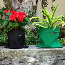 Greenbo - Greenbo Fiorina Planter Case - GFC01-B-0 - Shop for Planters and Pottery from Hayneedle.com! Inspired by Chinese paper lanterns the Greenbo Fiorina Planter Case is a modern solution to caring for your favorite plants indoors or out. The Fiorina Planter Case is made from waterproof fabric with a gentle mild design to place around your home giving it a soft calm look. Place your potted plant within the case for a modern alternative to a standard drain tray. Available in your choice of color. About Greenbo: Greenbo creates unique products which implement nature's most important elements into the product design encouraging us to explore how we can live in perfect harmony with our environment. Greenbo was founded in 2007 and brings design & creativity to the manufacturing of high-end smart products for the home and garden. Greenbo is based on simplicity innovation efficiency and safety above all. Greenbo cares about the environment and acts according to the ecological and economic principles of sustainability.