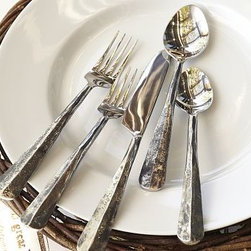 """Ridge Flatware, 5-Piece Place Setting - A richly distressed patina on each handle contrasts with gleaming tips to give our Ridge Flatware a distinctly modern look. Dinner Fork: 1"""" wide x 8.5"""" long Dinner Spoon: 1.5"""" wide x 8"""" long Knife: 1"""" wide x 9.5"""" long Salad Fork: 1"""" wide x 7.5"""" long Dessert Spoon: 1.5"""" wide x 7.5"""" long Handle is 18/8 stainless steel, forged to give a warn finish. Blade is 18/8 stainless steel with a shiny polished finish. Set of 5 includes one of each. Dishwasher-safe."""