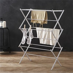 Large Folding Drying Rack - Laundry room essential in epoxy-coated steel. Rack expands to offer multiple drying rods, fold flat when not in use (see additional photos).