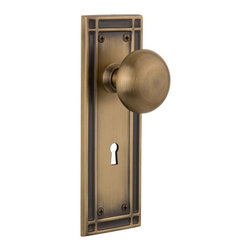 Nostalgic Warehouse - Nostalgic Mission Plate with New York Knob and Keyhole in Antique Brass (715886) - The Mission plate in antique brass harkens to the Spanish Colonial period of the Western frontier, with an instantly recognizable square corner. Add our New York knob, with its smooth round shape, for a look that will forever be refined. All Nostalgic Warehouse knobs are mounted on a solid (not plated) forged brass base for durability and beauty.