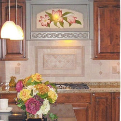 The Range Hood is the Centerpiece of the Kitchen - How about flowers? We enlisted the services of a local faux painting artist to turn a wood panel into a work of art. Again, the creative use of tile completes the effect.