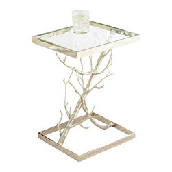 """Z"" Tree Table - Within a burnished forest of gracefully-modeled silver branches the sculptural naturalism that forms the tableau of the Z Tree Table's base lies a decisive diagonal structure that links the clear glass top to the open silver base, confining the woodland appeal between dual mirrored frames that emphasize the natural textures by contrast with their gloss, creating a stunning focal piece with a useful purpose."