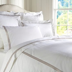 Grand Embroidered Sham, Euro, Lapis Blue - Edged by a triple row of contrast embroidery, our smooth, cotton duvet cover and sham take their cue from bedding found in the finest boutiques and hotels. Pure cotton percale. 280-thread count. Edged with a triple row of satin-stitched embroidery. Duvet cover has a hidden button closure and interior ties to keep the duvet in place. Sham has an envelope closure. Duvet cover, sham and insert sold separately. Monogramming is available at an additional charge. Monogram will be centered on the duvet cover and the sham. Machine wash. Catalog / Internet only. Imported.