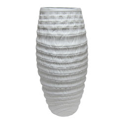 Bahari - Porcelain Coco Vase - Our matte finish, milky-white porcelain Coco Vase has a cylindrical shape and ribbed design that adds an organic sensibility to any floral arrangement or grouping of objects. Using traditional kiln-fired techniques that have been employed since porcelain originated each piece is hand-turned and crafted, thus every piece has its own character.