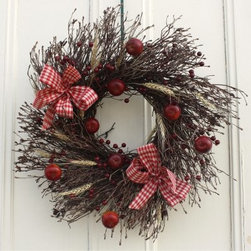 22 in. Twig Apple Harvest Wreath - Welcome fall to your home with the 22 in. Twig Apple Harvest Wreath. This handsome twig wreath is decorated with faux red apples, berries, and natural wheat grass with a trio of red and white checked bows.Care instructions: If you plan on keeping your wreath indoors, be sure to mist it every other day to maintain freshness and fragrancy. For safety, keep the wreath away from radiators, televisions, woodstoves, and other heat sources. If used on your door's exterior, do not put the wreath between storm doors. Store your wreath in a cool place when not in use.About Worchester Wreath CompanySince 1971, Worchester Wreath has been a family owned and operated company specializing in high quality, handmade wreathes. Based out of Maine, they have grown into the premier wholesaler of holiday balsam products, providing customers with beautiful wreaths, trees, and table centerpieces. Worchester Wreath Co. even operates its own 4,000 acre forest of Balsam fir, in which their products are made from.