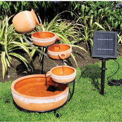 Koolatron - Koolatron 5 Tier Solar Cascading Fountain Multicolor - CSFK-5 - Shop for Fountains from Hayneedle.com! The Koolatron 5 Tier Solar Cascading Fountain adds a soothing sound and a charming old-world style while asking almost nothing of you. Just add a bit of water to this fully-contained unit and you're ready to go. The five-piece fountain of natural terra cotta is supported by a metal stand that allows water to splash from top to bottom when powered by the low-voltage pump. The solar panel can be staked into the ground near the pump which provides all the necessary power to run the pump.About KoolatronKoolatron is a Canadian company with headquarters in Brantford Ontario a branch office in Orlando Florida and warehouse locations in Batavia New York and in Rochester Kent in the United Kingdom. Your satisfaction is important to Koolatron and they value your trust. That's why they're committed to providing quality products and supporting every product they provide.