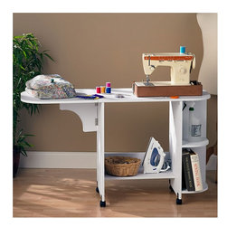 Wildon Home � - Duncan Laminate Sewing Table - Sew away and then roll away with this easy to store, folding, rolling table. If you love to sew but your hobby takes up too much space, this piece was meant for you. You have a large work surface that folds down and plenty of shelf space. Get your hobby rolling today and make this table your one piece sewing solution! Features: -Sewing table.-Easy mobility with its convenient wheels.-Three shelve-spaces.-Foldable top work surface.-Distressed: No.Dimensions: -Dimensions (with table extended): 29.5'' H x 31.5'' W x 19'' D.-Overall Product Weight: 47 lbs.Assembly: -Features:.-Assembly required.