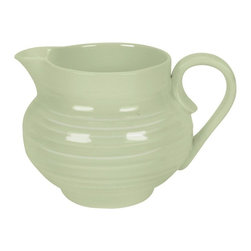 Portmeirion - Sophie Conran Sage Cream Jug - 456143 - Shop for Condiment Supplies from Hayneedle.com! The Sophie Conran Sage Cream Jug serves up a style you are sure to adore. Crafted of durable porcelain this small jug will blend beautifully with your cups saucers and coffee urn or teapot. Pair it with the matching sugar jar for a color-coordinated set your friends can't help but admire.About PortmeirionStrikingly beautiful eminently practical refreshingly affordable. These are the enduring values bequeathed to Portmeirion by its legendary co-founder and designer Susan Williams-Ellis. Her father architect Sir Clough Williams-Ellis was the designer of Portmeirion the North Wales village whose fanciful architecture has drawn tourists and artists from around the world (including the creators of the classic 1960s TV show The Prisoner). Inspired by her fine arts training and creation of ceramic gifts for the village's gift shop Susan Williams-Ellis (along with her husband Euan Cooper-Willis) founded Portmeirion Pottery in 1960. After 50+ years of innovation the Portmeirion Group is not only an icon of British design but also a testament to the extraordinarily creative life of Susan Williams-Ellis.The style of Portmeirion dinnerware and serveware is marked by a passion for both pottery manufacturing and trend-setting design. Beautiful tactile nature-inspired patterns are a defining quality of Portmeirion housewares from its world-renowned botanical designs modeled on antiquarian books to the breezy natural colors of its porcelain and earthenware. Today the Portmeirion Group's design legacy continues to evolve through iconic brands such as Spode the Pomona Classics collection and the award-winning collaboration of Sophie Conran for Portmeirion. Sophie Conran for Portmeirion:Successful collaborations have provided design inspiration throughout Sophie Conran's life. Her father designer Sir Terence Conran and mother food writer Caroline Conran have been the pillars of her ec