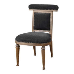 "Uttermost Tyrah Velvet Accent Chair - Plush, pewter velvet on the welted, padded seat back makes a soft place to lean or put your coat.  Trimmed by hand with folded fabric tape and antique brass accent nails, the frame is constructed of solid oak with natural finish and light antiquing glaze. Plush, pewter velvet on the welted, padded seat back makes a soft place to lean or put your coat. Trimmed by hand with folded fabric tape and antique brass accent nails, the frame is constructed of solid oak with natural finish and light antiquing glaze. Seat height is 18.5""."